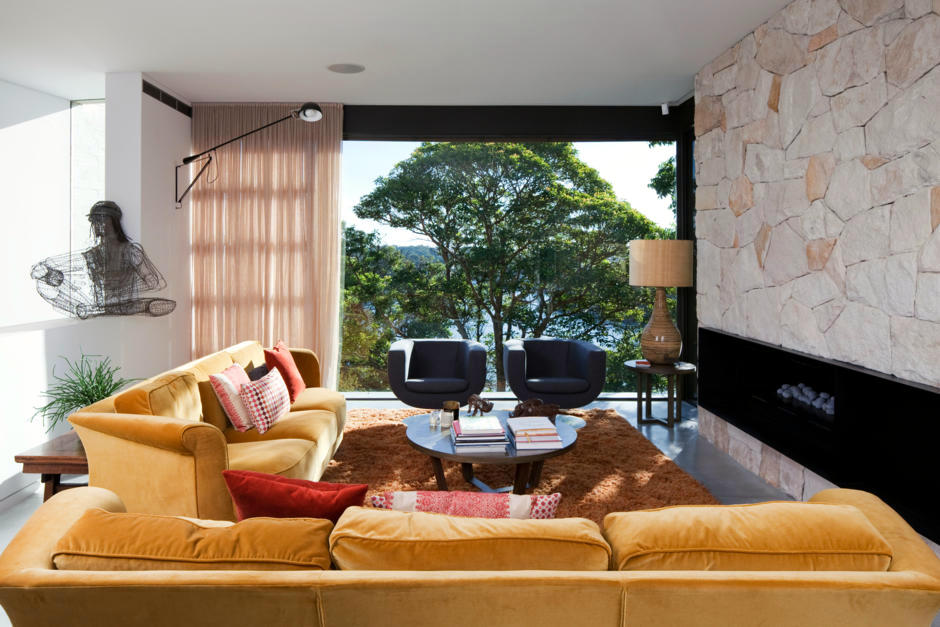 Yellow Couch In Front Of The Stone Wall