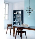 wooden-table-in-front-of-a-wall-of-pastel-color-0-149
