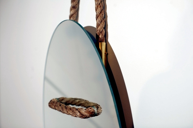 Modern design mirror suspended with hemp rope on the wall