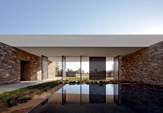 Stone and glass opens to the landscape