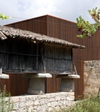 a-modern-house-is-located-in-an-old-farm-0-189