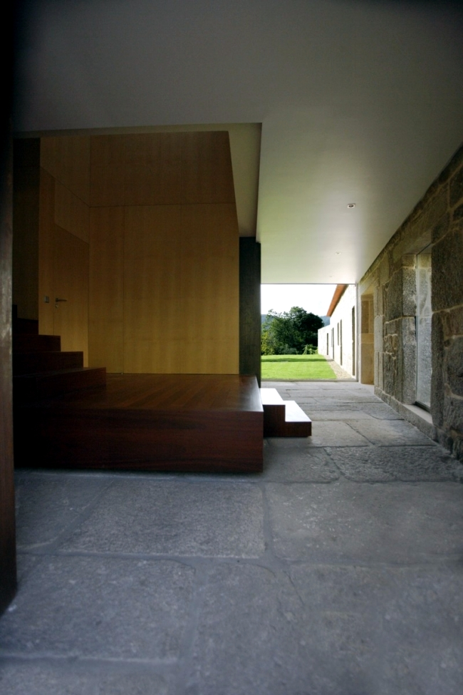 A modern house is located in an old farm