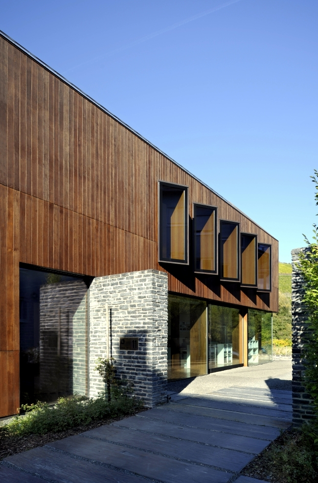 Stone Building Facade : An energy efficient home dressed in solid wood and stone