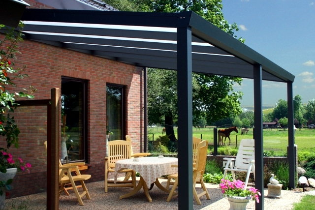 Aluminium windows and wooden ceilings provide a protected seat