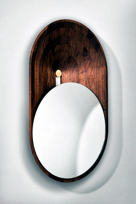 A mirror wall design in polished brass and black walnut