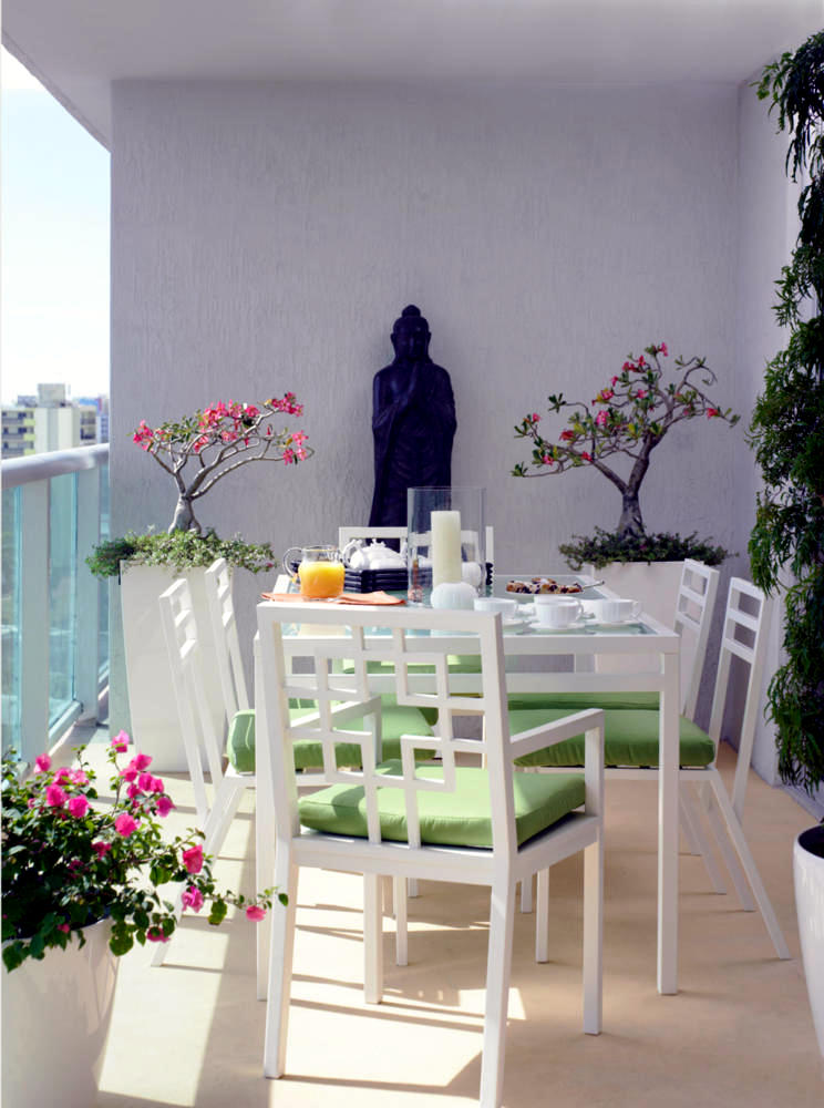 Buddha Statue On The Balcony With White Furniture