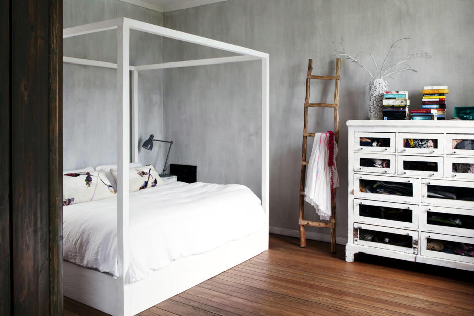 Canopy Bed Against The Wall With Minimalist Faux Finish