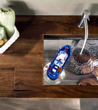 a-wood-vanity-with-glass-basin-of-lake-creates-illusions-0-259