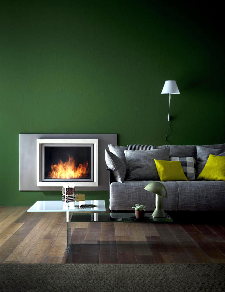 Fireplace In Front Of A Green Wall Interior Design Ideas