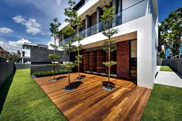 Wood Outdoor Patio Creates A Visual Link Between The Front Of The House