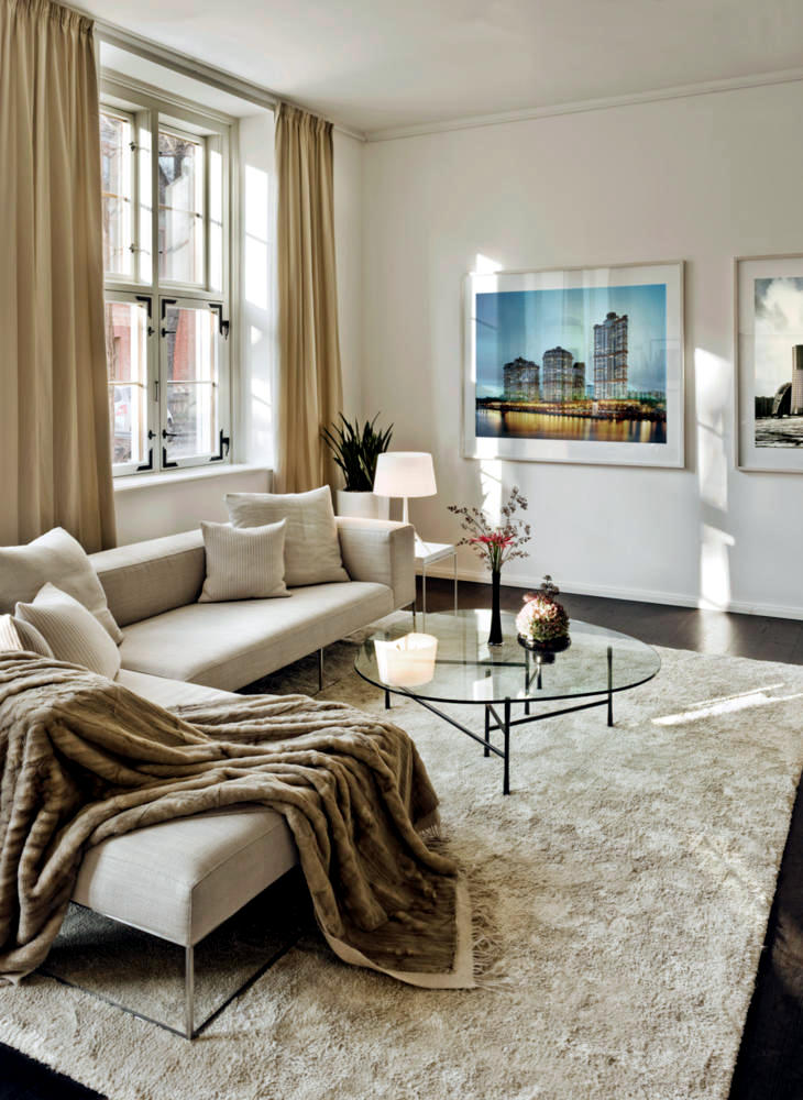 creamy white sofa and coffee table with glass top. Black Bedroom Furniture Sets. Home Design Ideas
