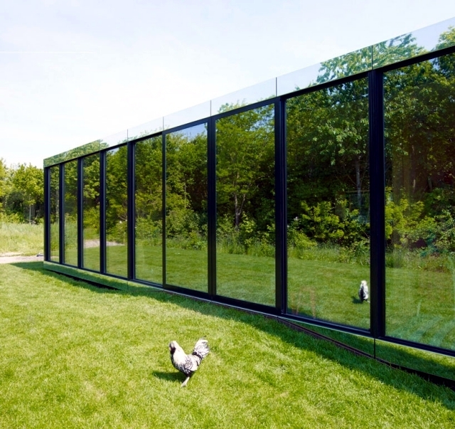 This modern flat deck with glass facade reflecting Johan Selbing