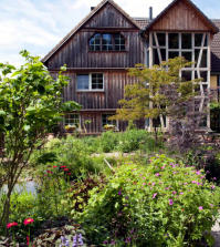 wooden-house-with-wild-garden-0-360