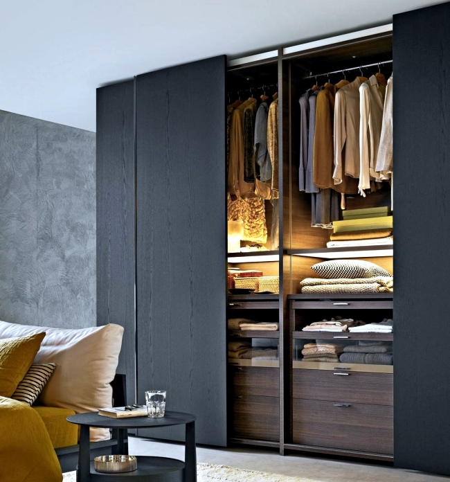 Wardrobe with sliding doors-A wonderful storage space under ...