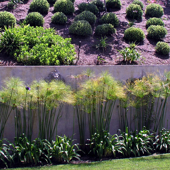 how to build a garden wall on a slope