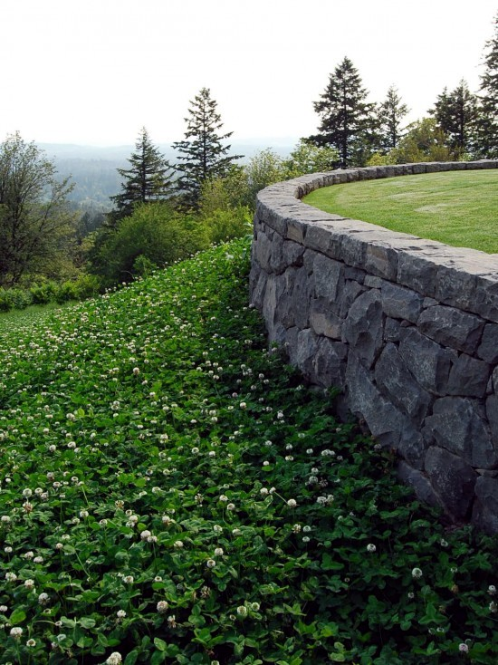 how to build a stone retaining wall on a slope