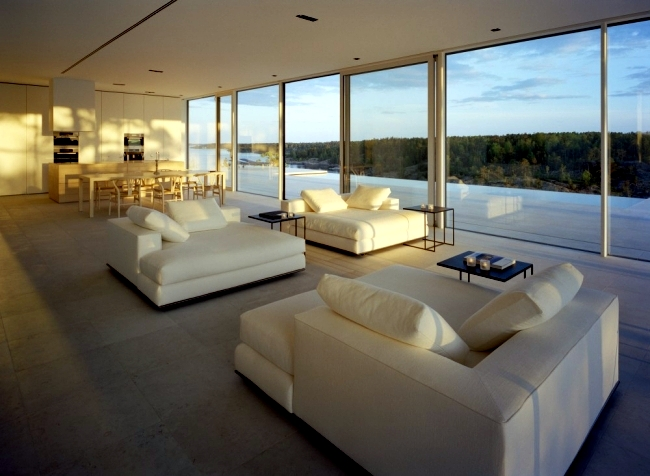 Fully glazed modern holiday villa located on a rocky hill in Sweden