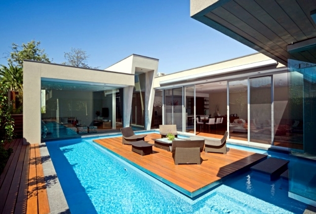Modern House In Canterbury A Wooden Deck By The Pool