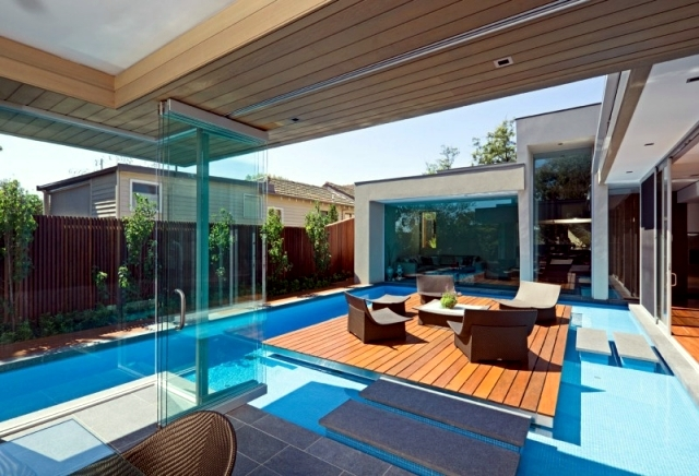 Modern House in Canterbury - A wooden deck by the pool