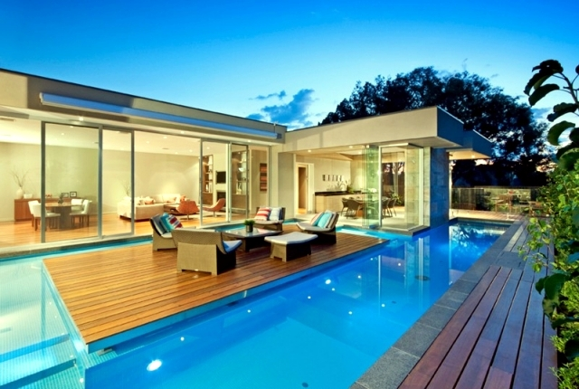 Modern house in canterbury a wooden deck by the pool wooded garden fence