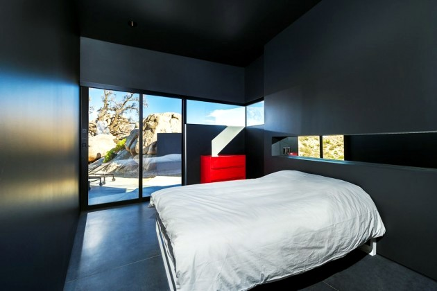 A black modern home in the California desert
