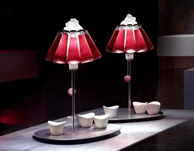 Designer table lamp Ingo Maurer Campari Bar produces light reflections