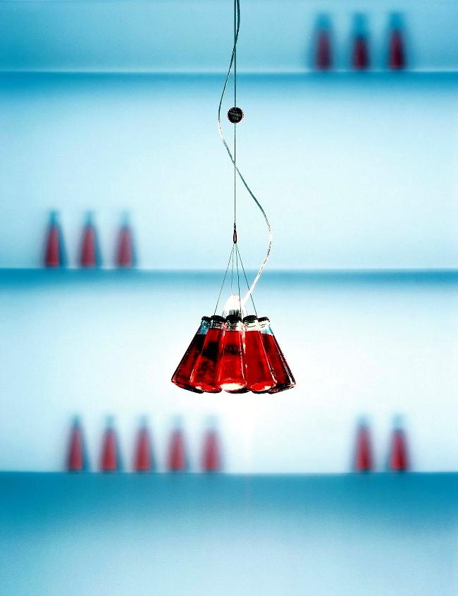 Designer table lamp Ingo Maurer Campari Bar produces light reflections