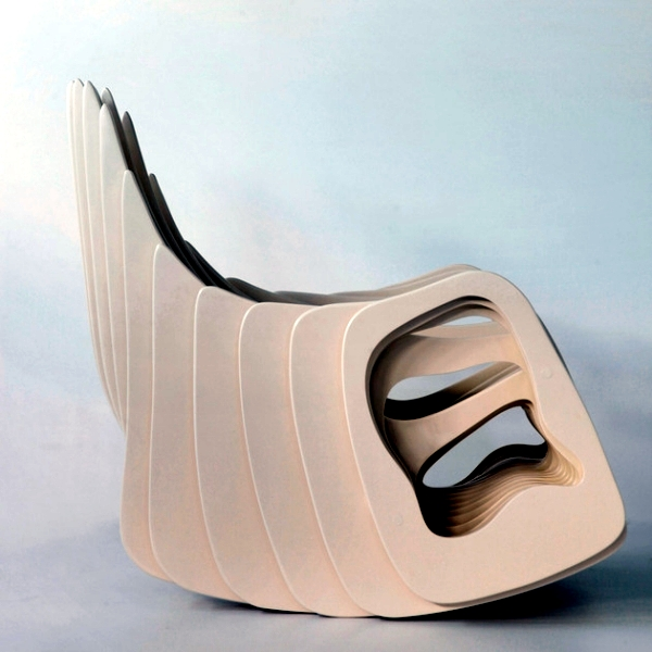 Designer wooden rocking chair with curved shapes of Eduardo Baroni