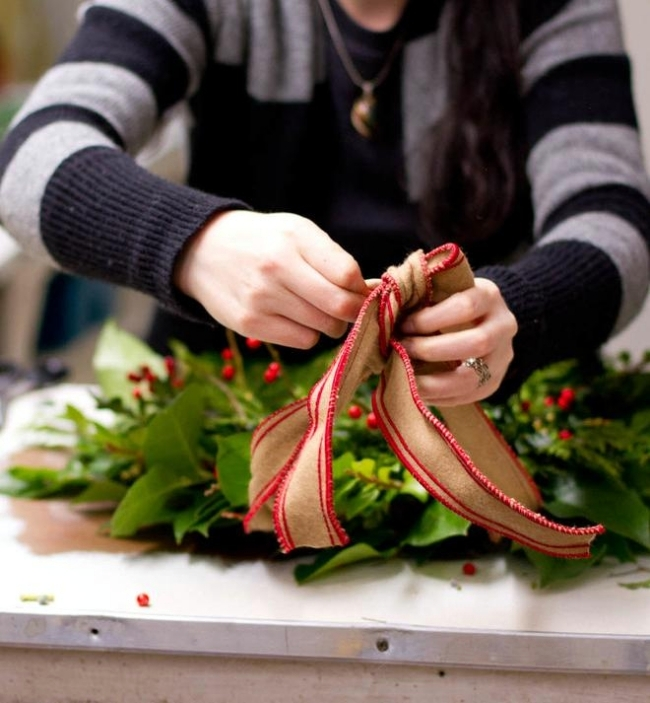 Playing with a beautiful door wreath evergreen Advent