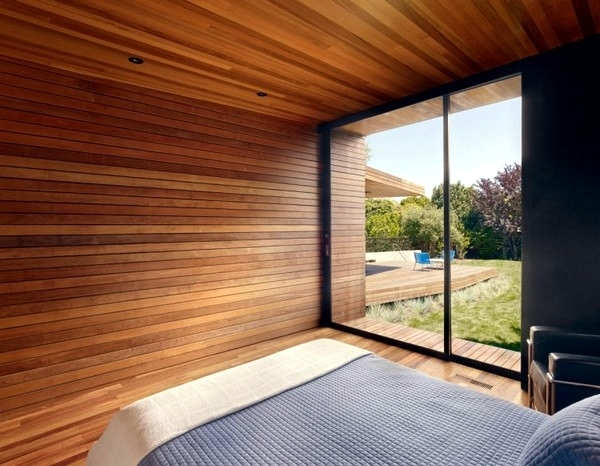 Contemporary wall cladding wood creates a warm interior for Interior paneling designs