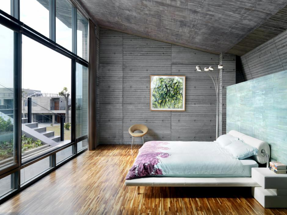 Concrete Walls And Windows In The Bedroom Interior