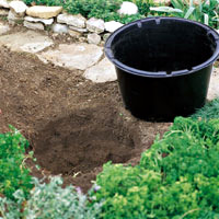 Create a mini garden pond in the mortar bed and replant - DIY Idea