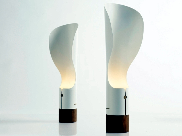 Contemporary table lamp rotates about the axis and the soft light and diffuse