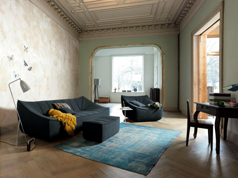 Old House With Designer Sofa And Armchairs Interpreted In