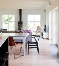 open-plan-living-room-with-light-wood-floors-0-560