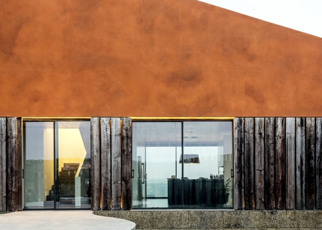 House in Portugal with copper colored paint stone