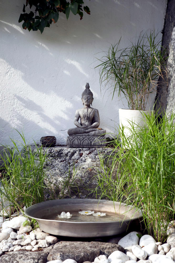 Buddha statue in the garden of natural stone Interior Design