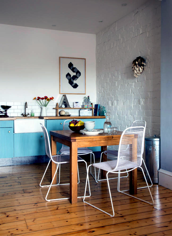 kitchen wire chairs in a modern dining room interior