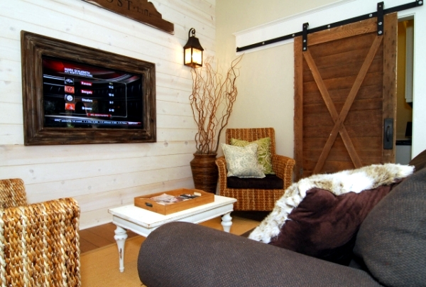 Wooden sliding door give the interior a rustic touch