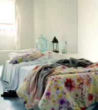 bright-bedroom-with-floral-bedding-0-677