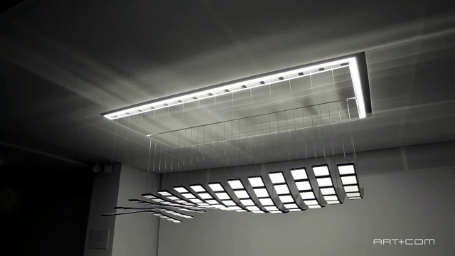 Kinetic OLED lamp design floating silently in space
