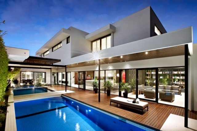 Modern house with pool surrounded by a spacious deck wood interior design ideas ofdesign Modern dream home design ideas