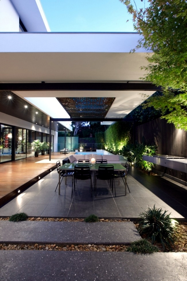 Modern house with pool surrounded by a spacious deck wood
