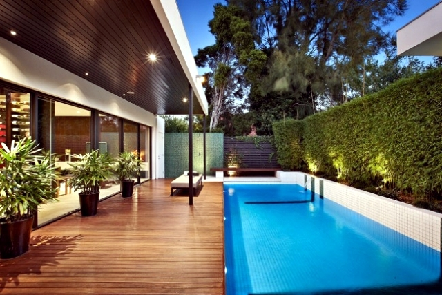Charming Modern House With Pool Surrounded By A Spacious Deck Wood