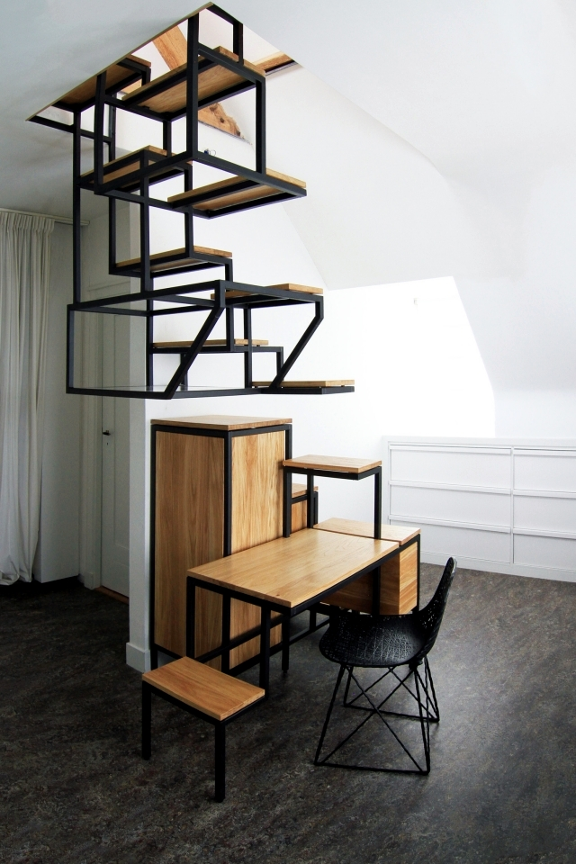A suspended staircase design workspace and provides plenty of storage