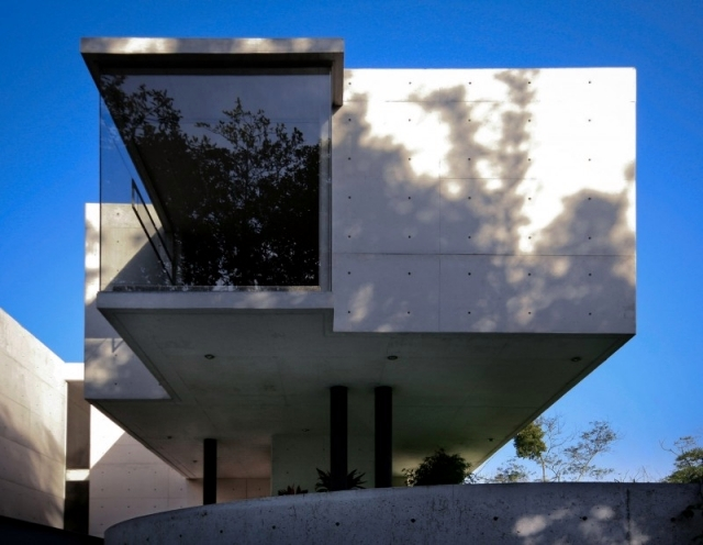 Modern concrete house of Mexico, with high ceilings and spacious interiors