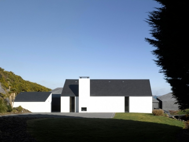 The conversion of a residential building on a rocky coastline in Ireland