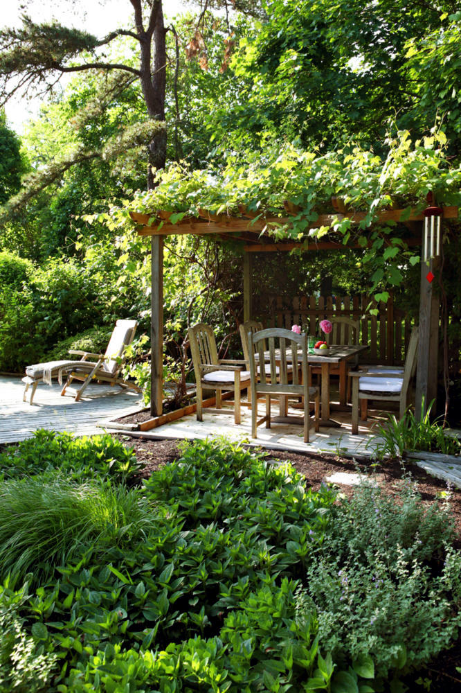 Natural garden with a covered sitting area interior for Garden area design