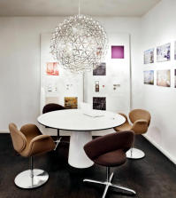 upholstered-chairs-with-a-retro-look-and-a-large-balloon-lamp-0-819