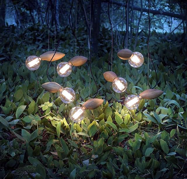 Pendant lamp modern wooden design resembles a firefly in the grass